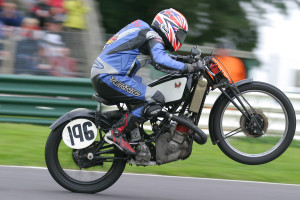 Paul Dobbs in inimitable action over the mountain on the Scott at Cadwell park, 2005